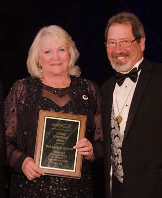 President Tooke-Rawlins receiving her award