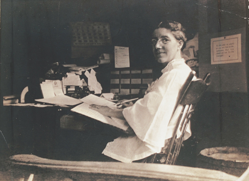 Charlotte Perkins Gilman writing at her desk, ca. 1916-1922 Courtesy Schlesinger Library, Radcliffe Institute, Harvard University