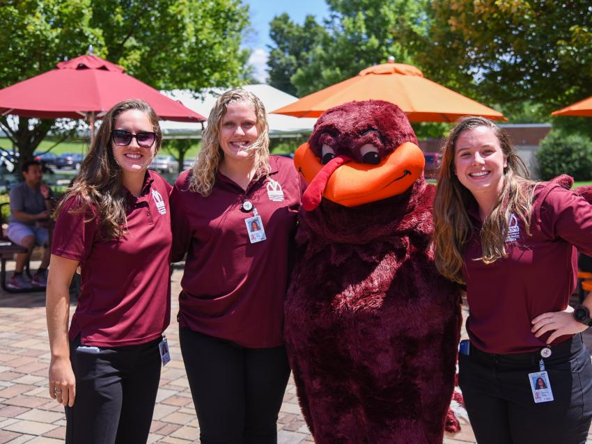 Students pose with the the Virginia Tech Hokie Bird mascot.